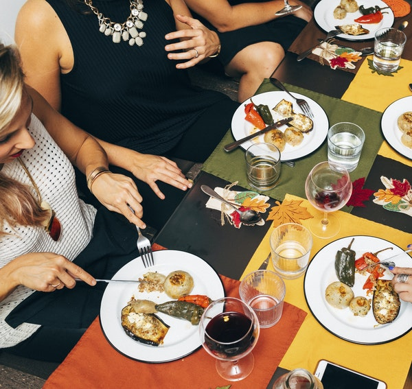Guests eat at a dinner organized by Eatwith, a communal dining service that is now in more than 200 cities.