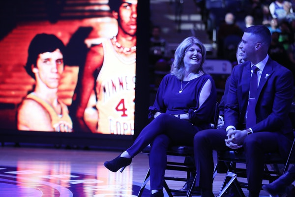 Debbie Saunders and son Ryan shared a laugh during a pregame ceremony honoring the late Flip Saunders in 2018. This weekend, a high school gym in his