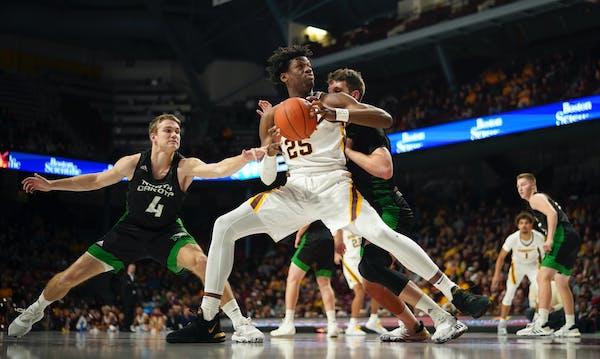 Gophers center Daniel Oturu leads the Big Ten in rebounding and is second in scoring.