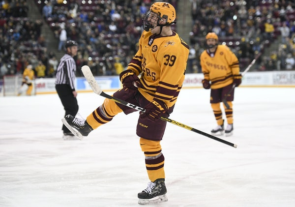 Gophers forward Ben Meyers celebrated his third period goal in last Saturday's victory against Ohio State.