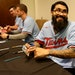 Minnesota Twins reliever Sergio Romo holds up a playing card from his days with the Los Angeles Dodgers during an autograph session as TwinsFest 2020
