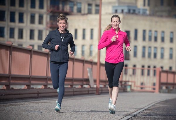 Carrie Tollefson, right, made her way across the Stone Arch Bridge for an early morning run May 2, 2017.