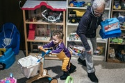 Ceola McClure-Lazo helped grandson Vail, 21 months, test out toys at the Toy Library.
