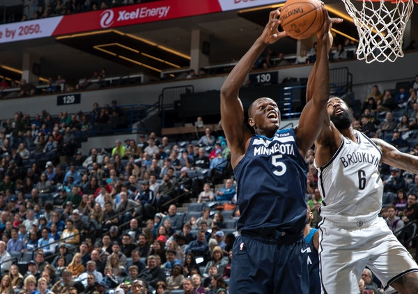 The Wolves' Gorgui Dieng (5) and the Nets' DeAndre Jordan battled for a rebound in the second quarter Monday. Dieng finished with 20 rebounds.