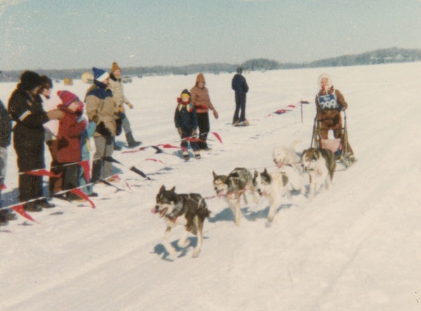 Sally Bair and her team crossed the finish line during the 1980 sled dog race on Lake Minnetonka.