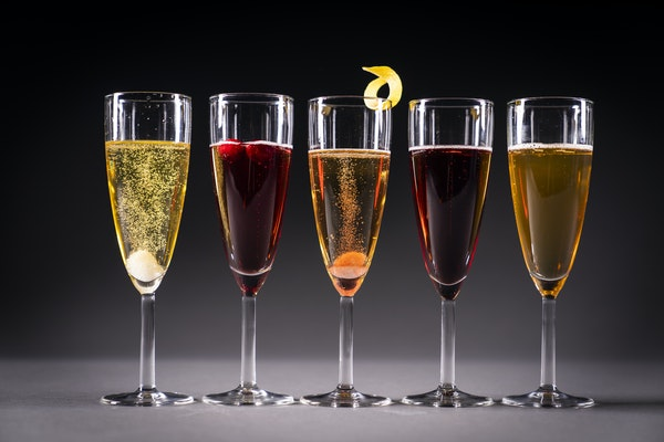 From left, Herbal Champagne Cocktail, Poinsettia, Classic Champagne Cocktail, Kir Royale and 50th & France.