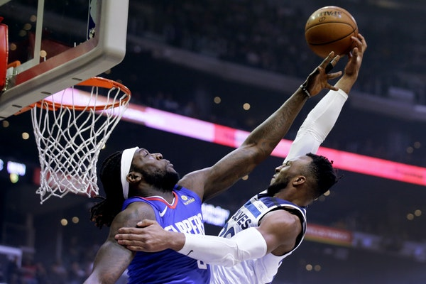 Wolves guard Josh Okogie attempted to shoot over Clippers forward Montrezl Harrell during the first half Saturday in Los Angeles.