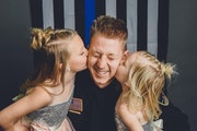 Waseca police officer Arik Matson with his daughters, Audrina and Maklynn, before his injury.