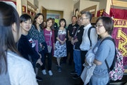 Pai Liu, left, led a group from China on a tour during orientation for parents of incoming U freshmen last summer.