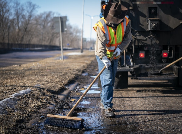 St. Paul city officials say they'd like to add a 1% sales tax to spend on prekindergarten services, housing and roads. Here, street service worker B