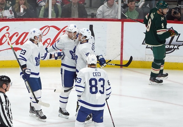 The Maple Leafs celebrated the first goal of the game.