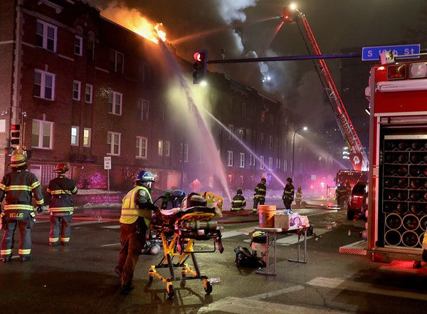 Firefighters battle a four-alarm fire at the Francis Drake Hotel apartments that broke out early Christmas Day morning Wednesday, Dec. 25, 2019, in Mi