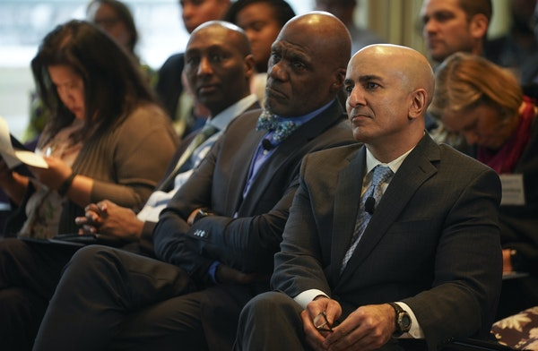 Retired Justice Alan Page, center, and Minneapolis Federal Reserve President Neel Kashkari, right, at Monday's forum.