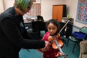 Instructor Ellie Fregni worked with Rafhaella Jimenez, 8, during her violin lesson Wednesday evening at Hopewell Music.