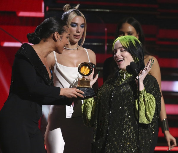 Alicia Keys, from left, and Dua Lipa present Billie Eilish with the award for best new artist at the 62nd annual Grammy Awards on Sunday, Jan. 26, 202