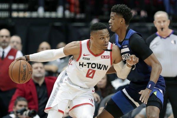 Houston Rockets guard Russell Westbrook (0) drives into Minnesota Timberwolves guard Jarrett Culver (23) during the first half of an NBA basketball ga