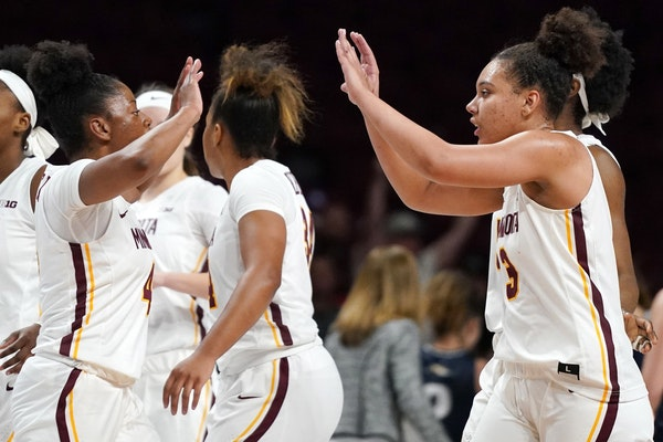 """Gophers guard Jasmine Powell (4) celebrated with Destiny Pitts (3) during a game against Montana State in November. """"Best teammate you could ever ask"""