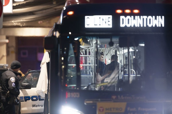 Minneapolis police investigated the scene on the Metro Transit bus where two people were shot Thursday night.