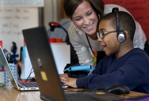 Emerson Spanish Immersion student Tayvin Stoll works after school on NASA-inspired computer games by Play Attention, powered by sensors reading one's