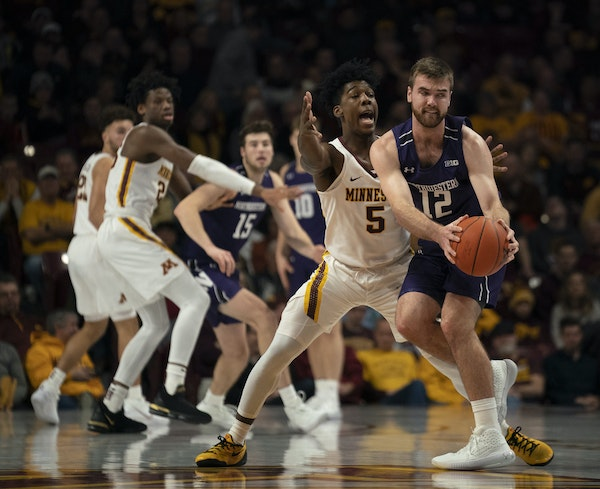 Gophers guard Marcus Carr ended up forcing a turnover by Northwestern guard Pat Spencer with his defense in the first half.