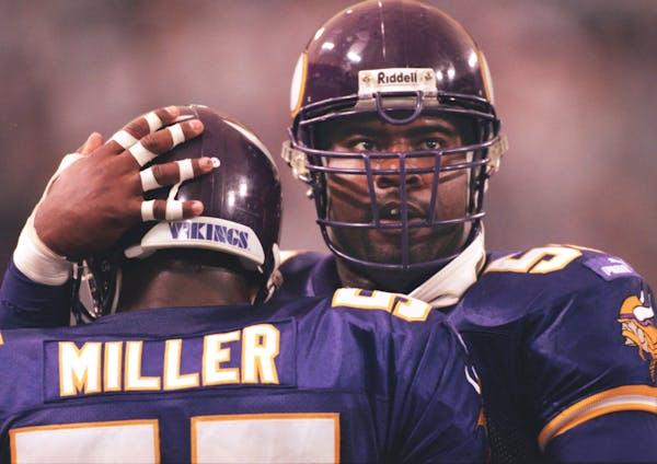 Vikings defensive end Chris Doleman, right, congratulates teammate Corey Miller after Miller intercepted a pass in 1999.