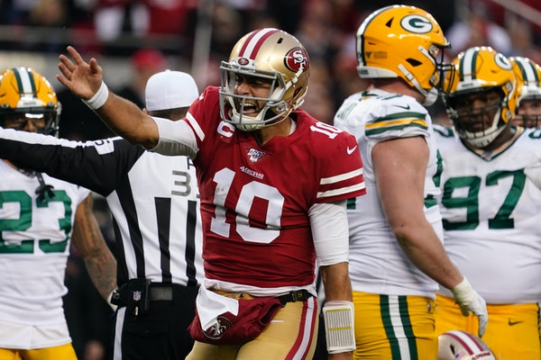 San Francisco 49ers quarterback Jimmy Garoppolo celebrates after converting a first down against the Packers during the NFC Championship Game