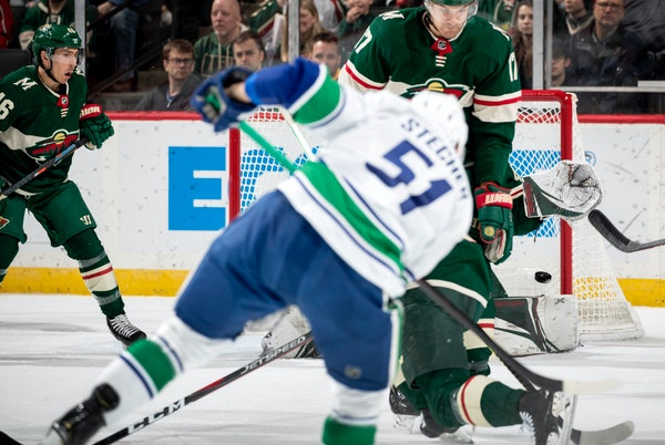 Vancouver's Troy Stecher (51) blasted the puck past Wild goalie Devan Dubnyk for a second-period goal in Minnesota's 4-1 loss at Xcel Energy Center on