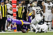 Minnesota Vikings wide receiver Adam Thielen (19) fumble on a pass reception which was recovered by the New Orleans Saints in the first half of an NFL