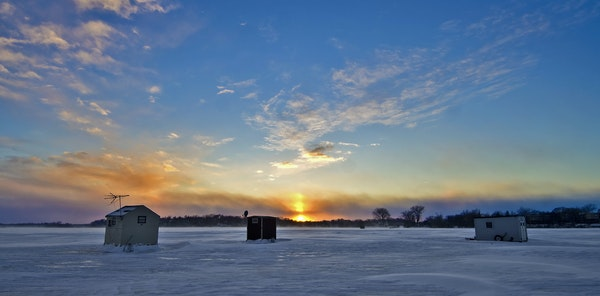 Ice fishing houses, like these photographed on Lake Minnetonka, are usually a common winter sight in Minnesota.