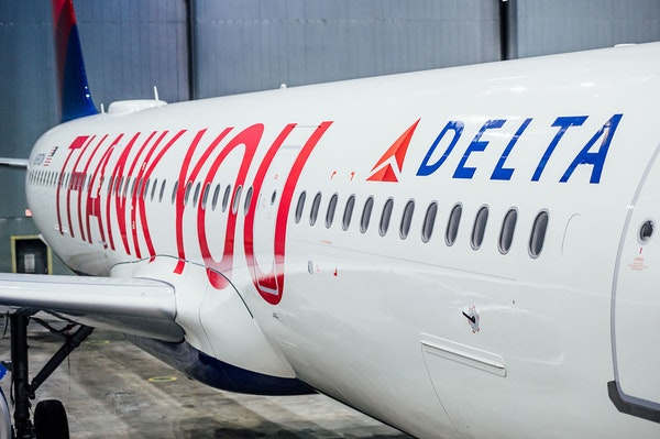 """Delta painted a large """"Thank you"""" and all of its employees' names on a plane as it distributed bonuses on Friday."""