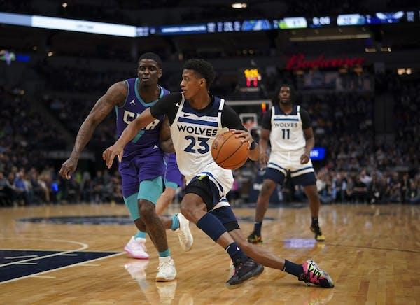 Minnesota Timberwolves guard Jarrett Culver (23) drove around Charlotte Hornets guard Dwayne Bacon (7) in the first half.