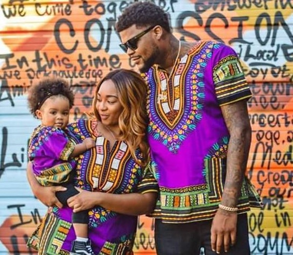 Rapper Jon Mitchell-Momoh, with his late partner, Monique Baugh, and one of their two daughters, 3-year-old Legend.