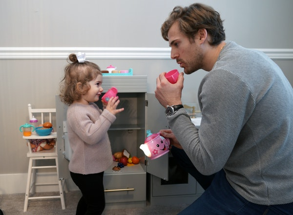 """Wild winger Marcus Foligno shared a cup of 'tea' with his daughter, Olivia, at home. He said having her """"gives you more purpose in life."""""""