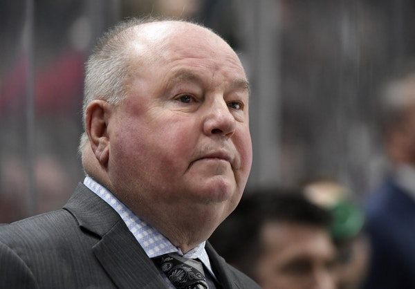 Minnesota Wild head coach Bruce Boudreau watches his team play against the Colorado Avalanche during the first period of an NHL hockey game Sunday, Fe