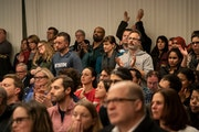 People stood in the back of the room when an overflow crowd attended the Minneapolis School Board meeting in Minneapolis, Tuesday, Jan. 14, 2020. Many