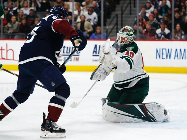 Wild goaltender Devan Dubnyk made a glove save on Avalanche left winger Matt Nieto looked on in the third period Friday. Dubnyk stopped 40 shots in th