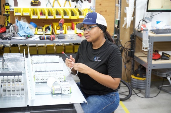 Kyla Sharp, an assembler of electronic control panels, sees her job as a career at growing Design Ready Controls in Brooklyn Park.
