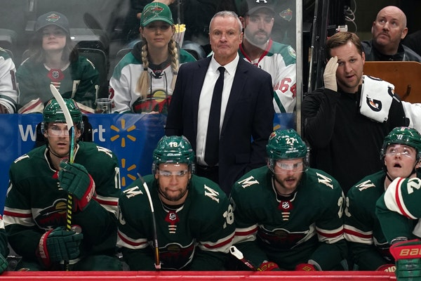 Wild interim coach Dean Evason watched from the bench in the second period.