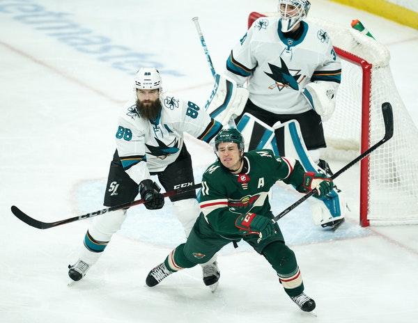 Wild left wing Zach Parise got a hard hit from San Jose Sharks defenseman Brent Burns in front of the San Jose net in the second period.