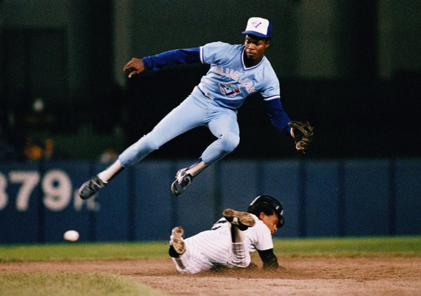 In this Sept. 18, 1987, file photo, the Yankees' Rickey Henderson, steals second base below Toronto shortstop Tony Fernández