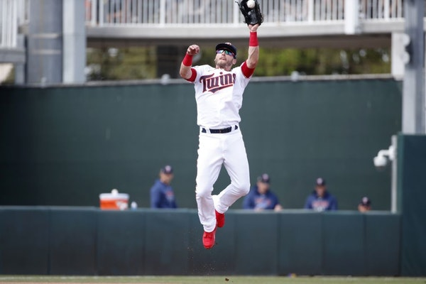 Minnesota Twins third baseman Josh Donaldson leaps to catch a line drive during a spring training baseball game against the Tampa Bay Rays, Friday, Ma
