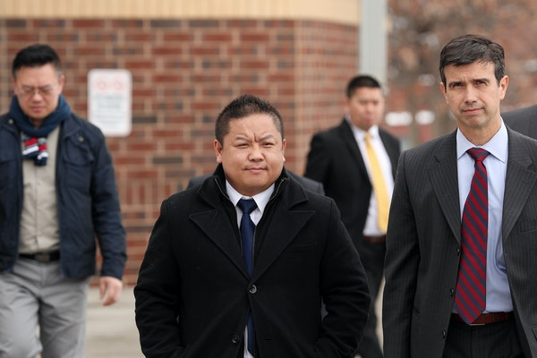 St. Paul City Council Member Dai Thao, left, walked with his attorney Joe Dixon, right, from the Ramsey County Law Enforcement Center following a hear