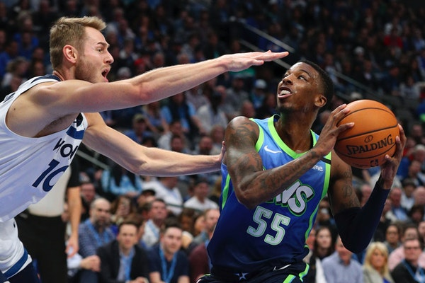 Timberwolves guard Jacob Evans tried to defend against a shot by Mavericks guard Delon Wright during the second half Monday.