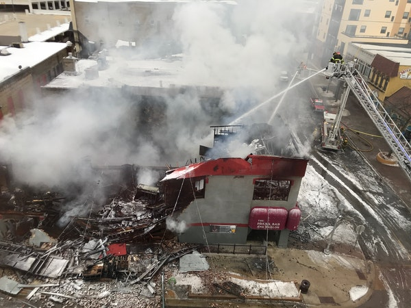 Firefighters battled a blaze at the Press Bar and Parlor in St. Cloud.