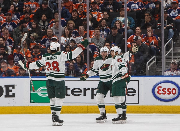 Minnesota's Ryan Hartman (38), Marcus Foligno (17) and Jared Spurgeon (46) celebrate a goal against the Oilers during the second period.