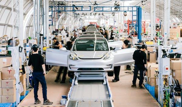 FILE -- A Tesla Model 3 assembly line at Tesla's factory in Fremont, Calif., on June 28, 2018. The electric-car manufacturerÕs shares were trading ab