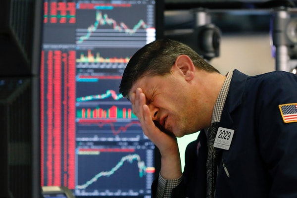 Trader Michael Gallucci works at his post on the floor of the New York Stock Exchange, Wednesday, March 11, 2020.