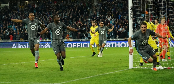 Minnesota United midfielder Ethan Finlay (13, right) celebrated after scoring a goal in the second half as midfielder Kevin Molino (7) and forward Ang