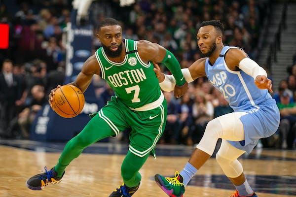 Boston Celtics guard Jaylen Brown drives against Timberwolves guard Josh Okogie (20) in the second quarter