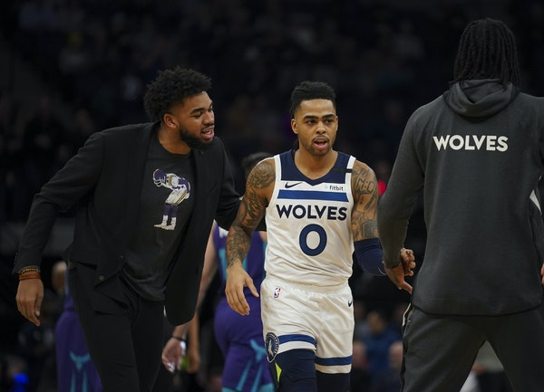 Karl-Anthony Towns had encouraging words for Minnesota Timberwolves guard D'Angelo Russell (0) during a recent game.